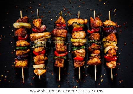 Chicken kebab grilling on barbecue Stock photo © Hofmeester