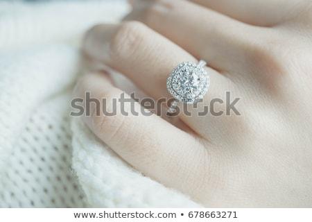 Közelkép fiatal nő visel gyémántgyűrű szög fényezés Stock fotó © AndreyPopov