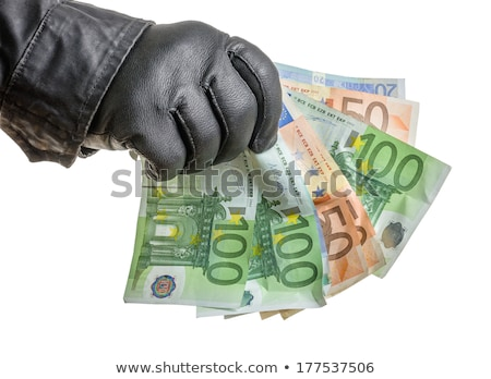 Thief with leather glove is grabbing some bills Stock photo © Zerbor