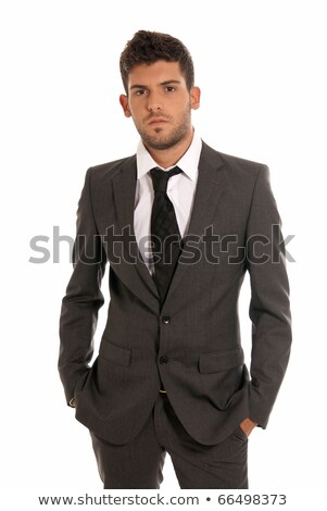 Portrait of a serious young businessman with hands in pockets stock photo © jaycriss