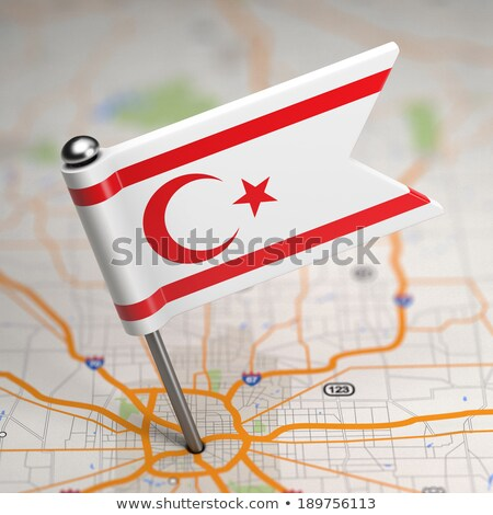 North Cyprus Small Flag on a Map Background. Stock photo © tashatuvango