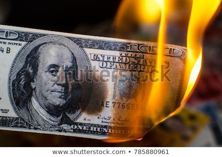 égő dollár egy száz dollár bank Stock fotó © cosma