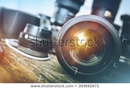 camera lens on the wooden table Stock photo © nessokv