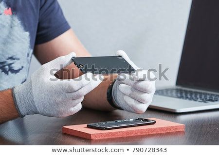 Reparar eletrônico negócio trabalhar telefone Foto stock © OleksandrO