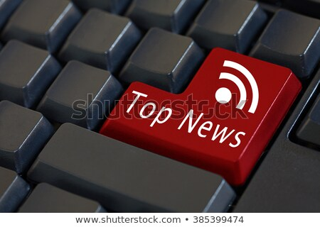 tablet pc on white background with breaking news title stock photo © stevanovicigor