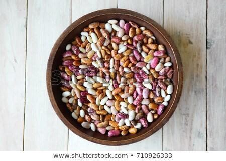 Dried pinto beans in a white bowl Stock photo © raphotos