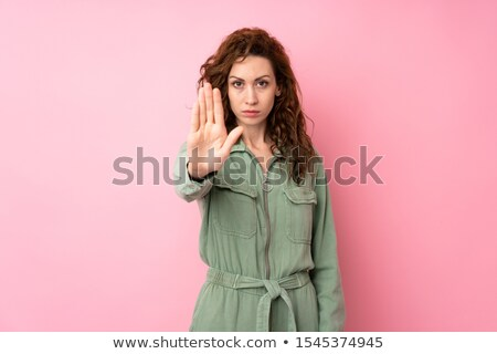 Attractive lady making stop gesture Stock photo © Aikon