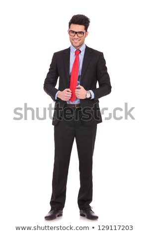 attractive young business man fixing his glasess stock photo © feedough