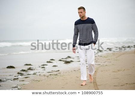 Solitário homem caminhada beira-mar abstrato silhueta Foto stock © xuanhuongho