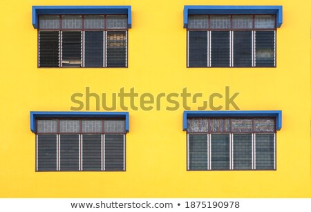 Four green arched windows on yellow wall Stock photo © Yongkiet