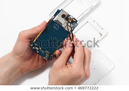 tweezers with a piece of the phone  Stock photo © OleksandrO