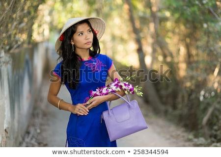 Bastante jovem mulher flores elegante Foto stock © smithore
