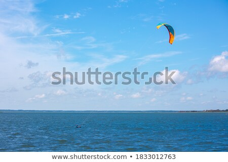 Power kite in sea and cloudy sky Stock photo © BSANI