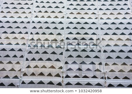 Close up of a high rise building covered in white tarpaulin. Stock photo © latent