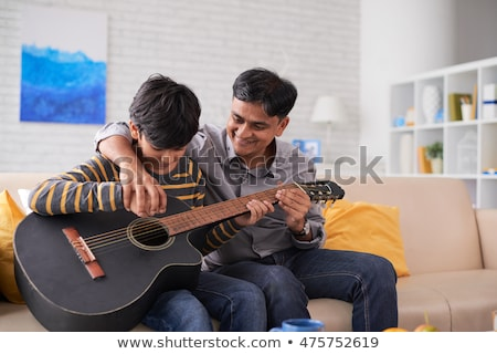 Father playing with his son in the Indians Stock photo © orensila