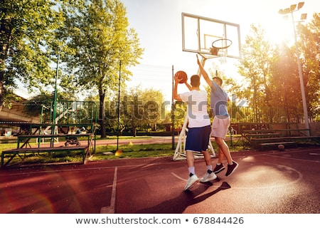 Sports man playing in basketball stock photo © deandrobot