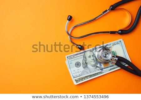 Medische zorg oranje medische stethoscoop pillen spuit Stockfoto © tashatuvango