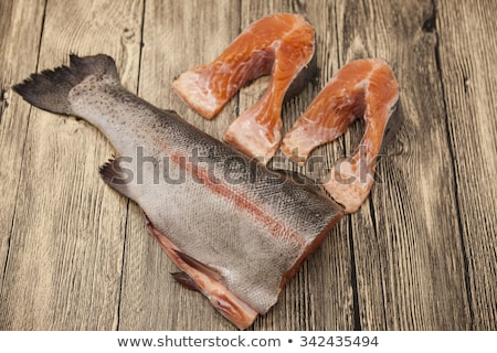 Fresh Norwegian rainbow trout steaks lying on the wooden background Stock photo © mcherevan