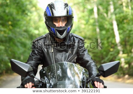 motorcyclist goes on road, front view, closeup Stock photo © Paha_L