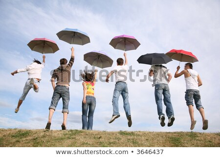 grupo · jovens · saltando · ao · ar · livre · grama · feliz - foto stock © paha_l