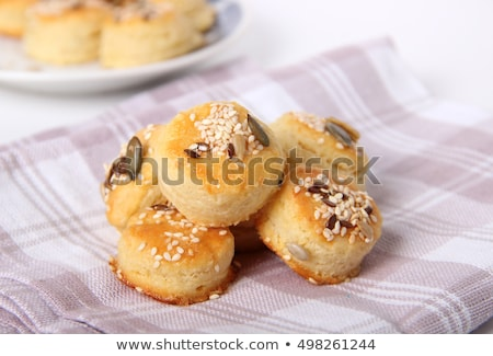 Stock photo: Fresh homemade salty scones with cheese and sesame