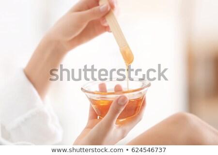Mujer caliente cera tazón spa Foto stock © wavebreak_media