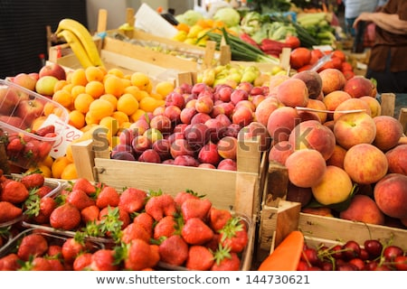 fresh organic strawberries in crate on farmers market stock photo © stevanovicigor