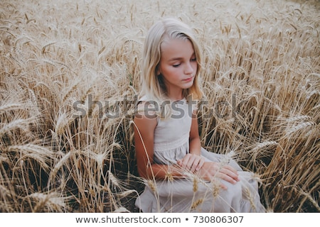 Girl sits in rye field Stock photo © bezikus