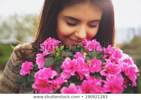 sevimli · esmer · çiçek · kadın · kız · bahar - stok fotoğraf © konradbak