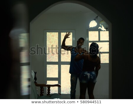 Sad And Depressed Woman Trapped At Home By Violent Husband Stock photo © diego_cervo
