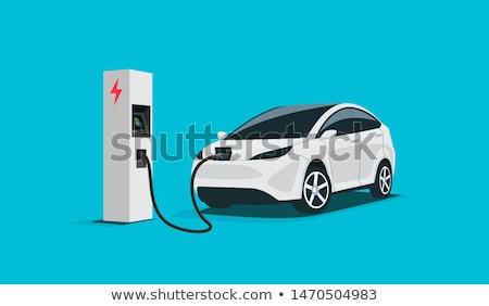 Elektrische auto jonge gelukkig man station vrolijk Stockfoto © RAStudio