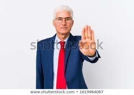 serious bearded man in shirt showing stop sign stock photo © deandrobot