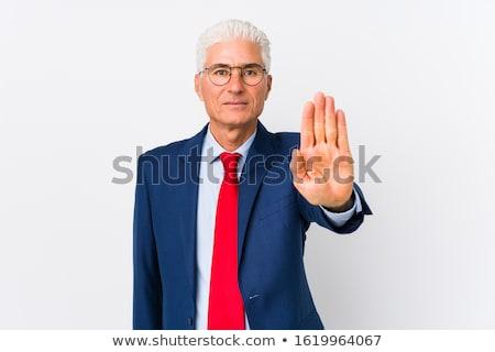 Komoly szakállas férfi póló mutat stoptábla Stock fotó © deandrobot