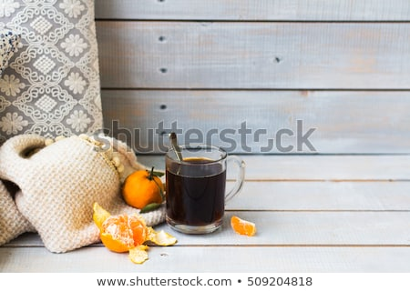 Aromatic black coffee and tangerines on light wooden background Stock photo © Yatsenko
