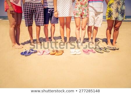 Low section of  woman sunbathing on beach Stock photo © monkey_business