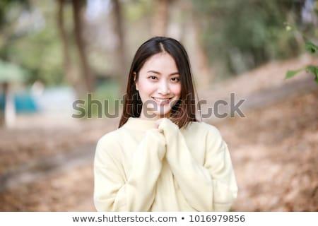 молодые · улыбаясь · азиатских · женщину · одежды - Сток-фото © deandrobot