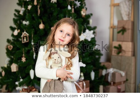 Happy child little girl standing at home against fireplace Stock photo © master1305
