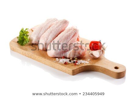 Raw uncooked chicken legs, drumsticks on wooden board, meat with ingredients for cooking Stock photo © yelenayemchuk