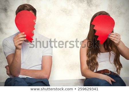 Young couple in fight against a white background Stock photo © julenochek
