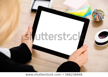 female executive using digital tablet at desk stock photo © wavebreak_media