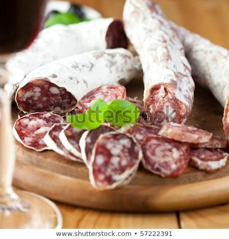 Ломтики · высушите · салями · разделочная · доска · продовольствие - Сток-фото © digifoodstock
