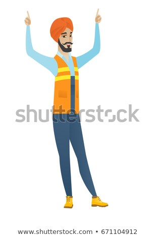 Young hindu builder standing with raised arms up. Stock photo © RAStudio