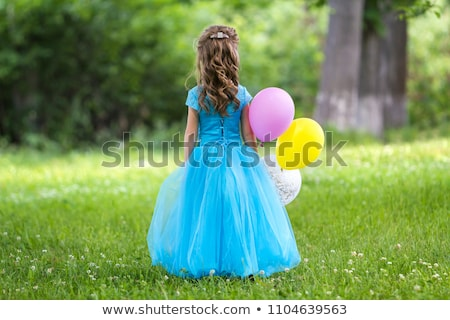 blonde girl in a blue dress on a yellow background stock photo © dmitriisimakov