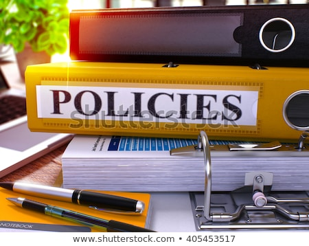 Yellow Ring Binder with Inscription Policies. Stock photo © tashatuvango