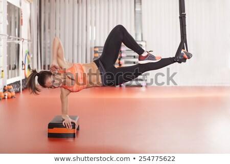 Suspensión formación gimnasio mujer ejercicio Foto stock © boggy