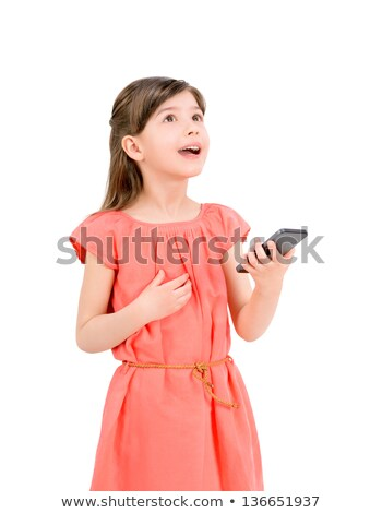 portrait of an excited little girl looking at mobile phone stock photo © deandrobot