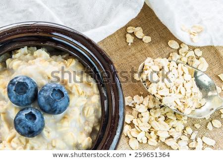 Cuchara frambuesas blanco leche desayuno Foto stock © Digifoodstock