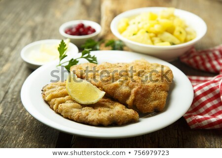 wiener schnitzels with potato salad stock photo © digifoodstock