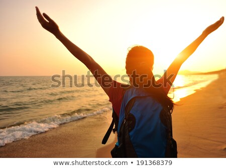 girl hiker with arms outstretched enjoy beach and sea stock photo © blasbike