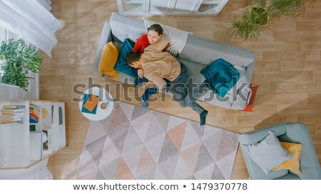 Young woman fooling around on floor with man Stock photo © Giulio_Fornasar